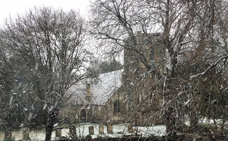 church from vicarage in winter
